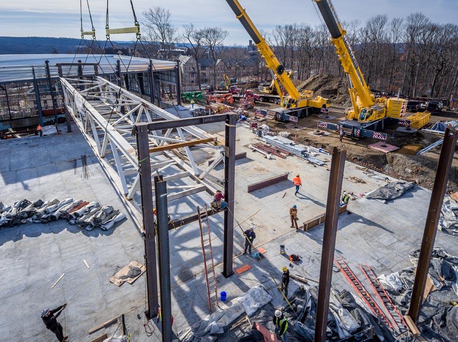 Cranes Lowering Steel Frames